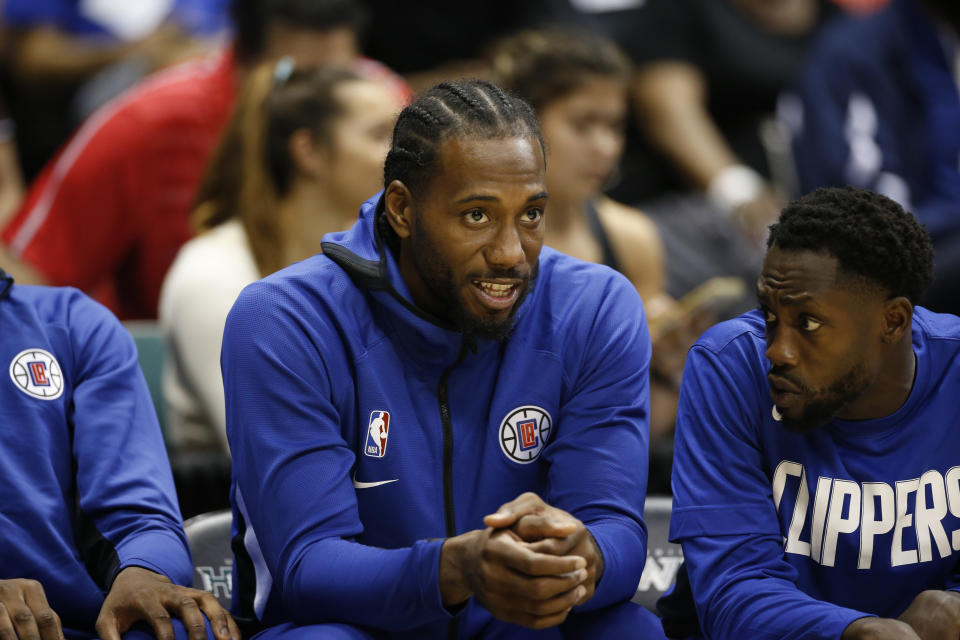 Los Angeles Clippers small forward Kawhi Leonard (2) sits on the bench during an NBA preseason basketball game against the Houston Rockets, Thursday, Oct 3, 2019, in Honolulu. (AP Photo/Marco Garcia)