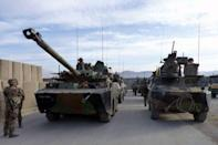 French military vehicles, which left French military Camp Nijrab in Kapisa province, arrive at French military Camp Warehouse in Kabul. France ended its combat mission in Afghanistan on Tuesday, withdrawing troops from a strategic province northeast of Kabul as part of a quickened departure from the war-torn country