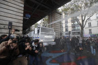 A police water canon vehicle advances during a banned protest in support of Palestinians in the Gaza Strip, in Paris, Saturday, May, 15, 2021. Marches in support of Palestinians in the Gaza Strip were being held Saturday in a dozen French cities, but the focus was on Paris, where riot police got ready as organizers said they would defy a ban on the protest. (AP Photo/Michel Euler)