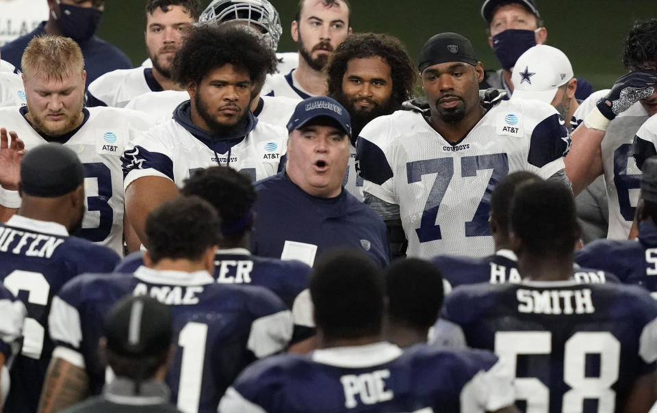 Dallas Cowboys head coach Mike McCarthy, center, speaks to the team during NFL football training camp in Frisco, Texas, Tuesday, Aug. 18, 2020. (AP Photo/LM Otero)