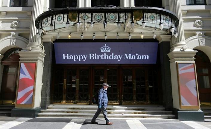 "A sign above the entrance to the shuttered London Palladium reads ""Happy Birthday Ma'am"", a birthday greeting to Britain's Queen Elizabeth II (AFP Photo/ISABEL INFANTES)"
