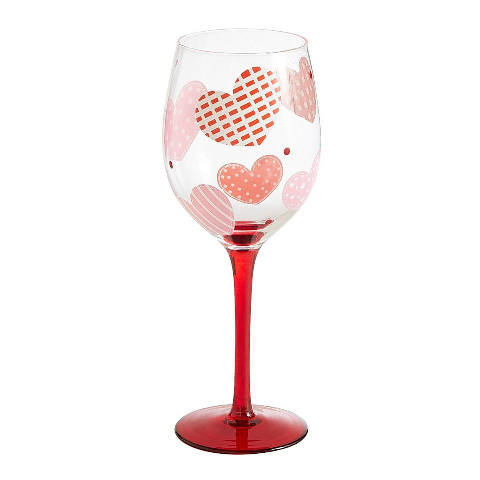 """<p>This <a rel=""""nofollow"""" href=""""https://www.popsugar.com/buy/Plaid%20Hearts%20Wine%20Goblet-404467?p_name=Plaid%20Hearts%20Wine%20Goblet&retailer=pier1.com&price=10&evar1=moms%3Aus&evar9=45663736&evar98=https%3A%2F%2Fwww.popsugar.com%2Fmoms%2Fphoto-gallery%2F45663736%2Fimage%2F45663964%2FPlaid-Hearts-Wine-Goblet&list1=shopping%2Cvalentines%20day%2Cdecor%20shopping%2Cpier%201%20imports&prop13=mobile&pdata=1"""" rel=""""nofollow"""">Plaid Hearts Wine Goblet</a> ($10) is so fun for Galentine's Day dinners.</p>"""