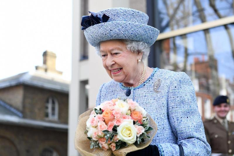 Kind gifts: The Queen recieved flowers from onlookers (EPA)