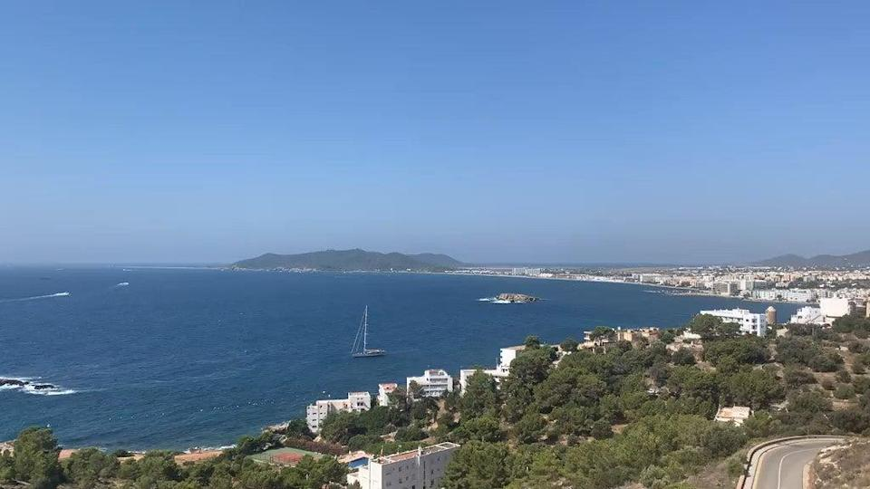 Those travelling back from Balearic islands such as Ibiza could have to self-isolate on their return, according to reports (PA Media)
