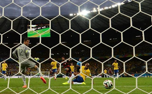 Brazil's goalkeeper Julio Cesar (left) concedes a goal to Germany's midfielder Sami Khedira (back centre) during the semi-final match at the Mineirao Stadium in Belo Horizonte during the 2014 FIFA World Cup on July 8, 2014 (AFP Photo/Vanderlei Almeida)