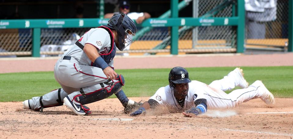 Tigers shortstop Niko Goodrum is tagged out by Twins catcher Alex Avila but ruled safe due to interference during the sixth inning of the Tigers' 8-2 win in Game 1 of the doubleheader at Comerica Park on Saturday, August 29, 2020.