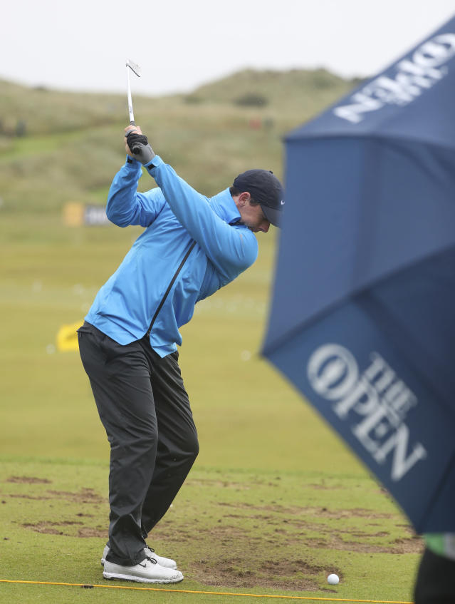 Northern Ireland's Rory McIlroy prepares to hit a shot on the practice range ahead of the start of the British Open golf championships at Royal Portrush in Northern Ireland, Wednesday, July 17, 2019. The British Open starts Thursday. (AP Photo/Jon Super)