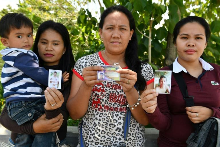 A year after jihadists invaded the Philippine city of Marawi, Alma Tome, Evelyn Powao, and Melgie Powao, still pray for the return of their missing husbands