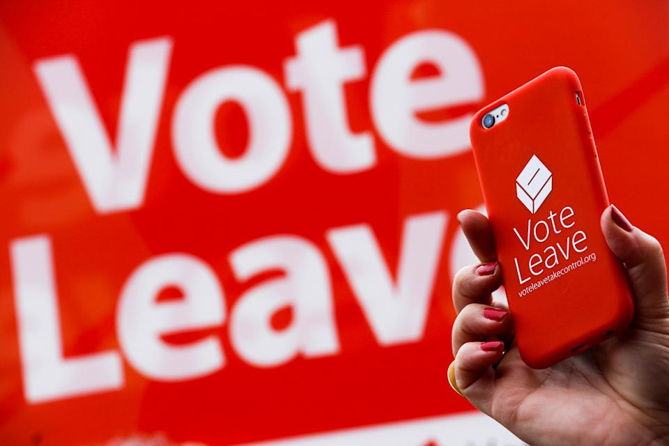 A Brexit supporter shows their support with their iPhone during the EU referendum campaign (Getty)