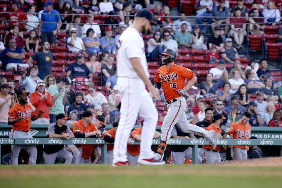 Baltimore Orioles' Trey Mancini (16) rounds the bases past Boston Red Sox relief pitcher Josh Smith (67) after hitting a home run during the ninth inning of a baseball game, Saturday, Sept. 28, 2019, in Boston. (AP Photo/Mary Schwalm)
