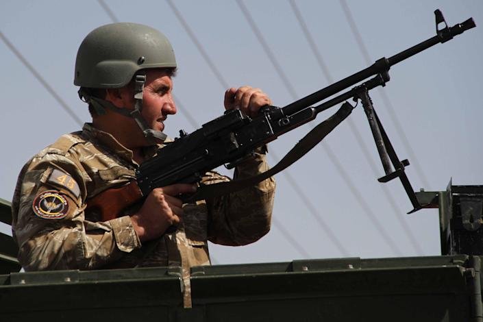 An Afghan security official in Herat, Afghanistan, on Saturday, where there is intense fighting by the Taliban. (EPA)
