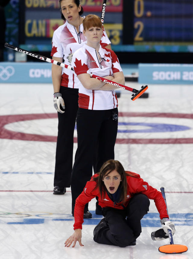 Britain's skip Eve Muirhead shouts to her sweepers after delivering the rock during the women's curling semifinal game against Canada at the 2014 Winter Olympics, Wednesday, Feb. 19, 2014, in Sochi, Russia. (AP Photo/Robert F. Bukaty)