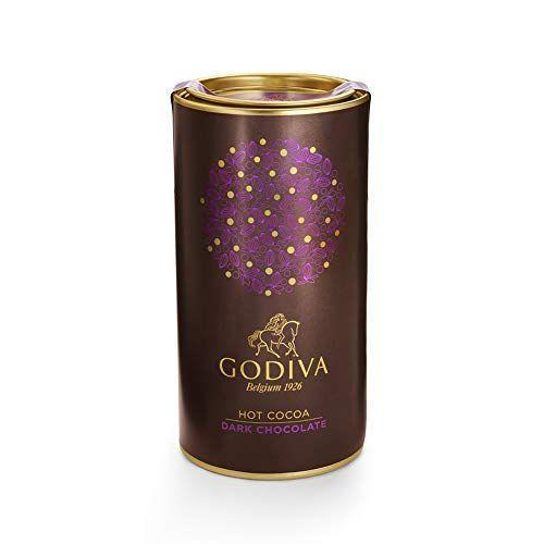 """<p><strong>Godiva Chocolatier</strong></p><p>amazon.com</p><p><strong>$15.95</strong></p><p><a href=""""https://www.amazon.com/dp/B07PML31RP?tag=syn-yahoo-20&ascsubtag=%5Bartid%7C2164.g.36792766%5Bsrc%7Cyahoo-us"""" rel=""""nofollow noopener"""" target=""""_blank"""" data-ylk=""""slk:Shop Now"""" class=""""link rapid-noclick-resp"""">Shop Now</a></p><p>This canister of dark chocolate hot cocoa mix contains at least 10 decadent servings. If you fancy yourself a chocolatier at heart, this might be your pick. </p>"""