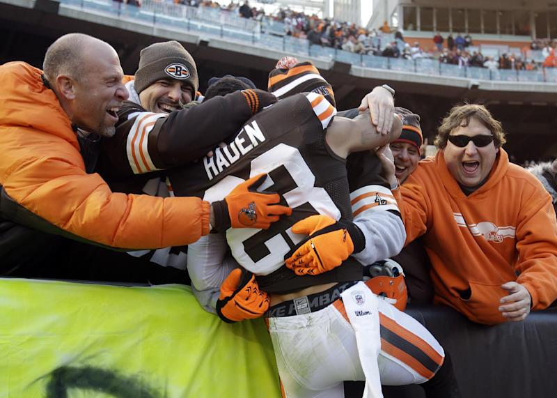 Cleveland Browns cornerback Joe Haden (23) is hugged by fans after a 20-14 win over the Pittsburgh Steelers in an NFL football game on Sunday, Nov. 25, 2012, in Cleveland. (AP Photo/Mark Duncan)
