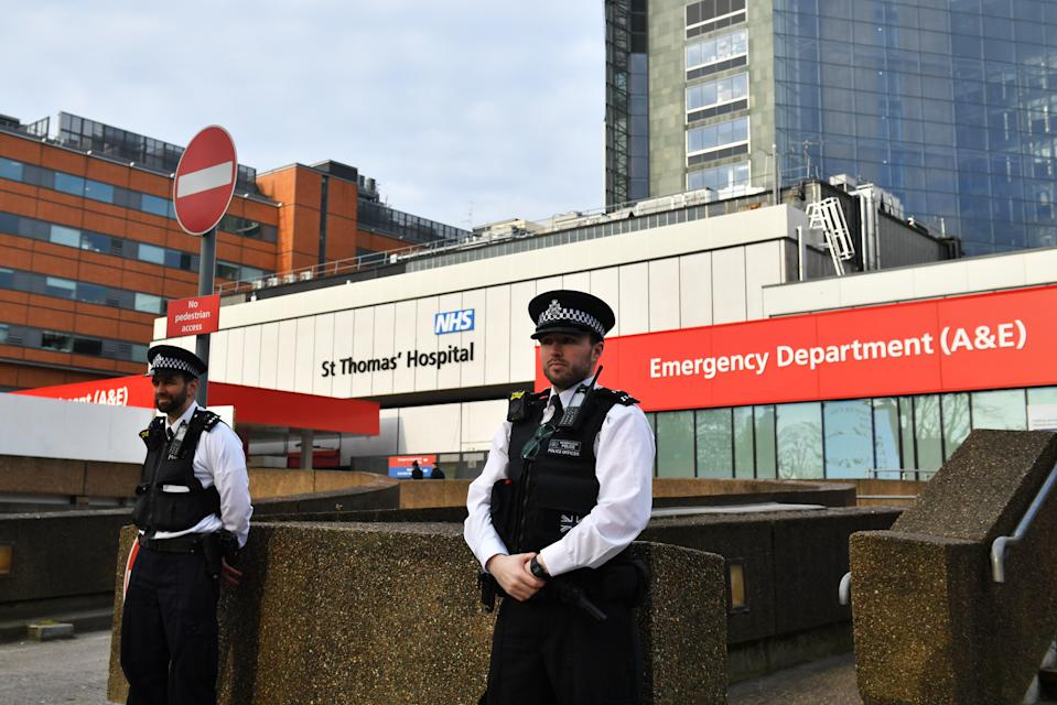 Police officers outside St Thomas' Hospital in Central London, where Prime Minister Boris Johnson remains in intensive care as his coronavirus symptoms persist.