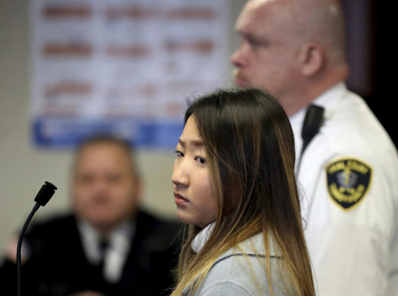 """Inyoung You, 21, appears in Suffolk Superior Court, Friday, Nov. 22, 2019, in Boston. The former Boston College student pleaded not guilty to involuntary manslaughter in a case accusing her of encouraging her boyfriend Alexander Urtula to take his life. Prosecutors say she sent Urtula more than 47,000 text messages in the last two months of the relationship, including many urging him to """"go kill yourself."""" (David L Ryan/The Boston Globe via AP, Pool)"""