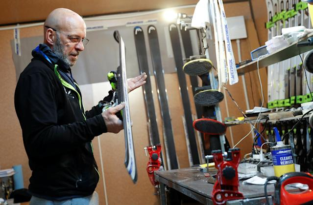 """Heinz Haemmerle, or """"Magic Heinzi"""" as US skier Lindsey Vonn calls her Austrian-born ski technician, checks the sharpness of the edges on a pair of skis of the world's most successful skiing women in his tiny waxing container at the Winter Olympics 2018 in Pyeongchang, South Korea February 19, 2018. Picture taken February 19, 2018. REUTERS/Leonhard Foeger"""