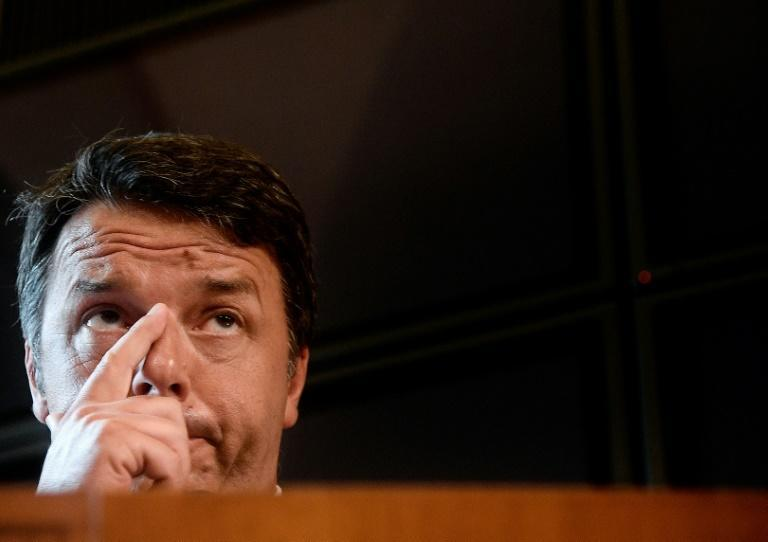 Former prime minister Matteo Renzi has proposed a M5S-PD alliance to pass the budget, despite past virulent exchanges between the two parties (AFP Photo/Filippo MONTEFORTE)