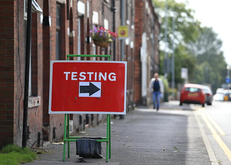A sign shows traffic where to turn to enter a COVID-19 testing centre in Oldham, Greater Manchester, northwest England on August 20, 2020. - Oldham, as of Thursday, has one of the highest rates of new COVID-19 infections, and could be subject to a imposed Local Lockdown to prevent the spread of the novel coronavirus. (Photo by Lindsey Parnaby / AFP) (Photo by LINDSEY PARNABY/AFP via Getty Images)