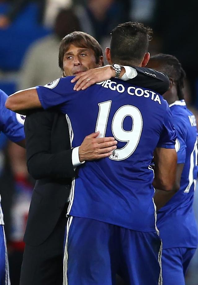 Chelsea's Diego Costa (R) celebrates with team manager Antonio Conte after their English Premier League 2-1 win over West Ham United, at Stamford Bridge in London, on August 15, 2016 (AFP Photo/Justin Tallis)