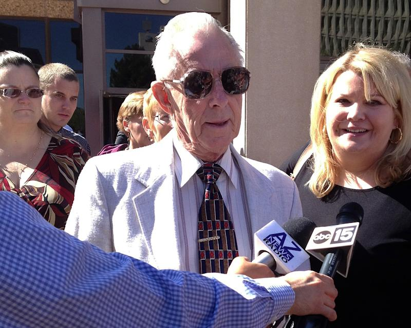 George Sanders, center, is joined by his attorney Janey Henze Cook, right, outside a Phoenix courtroom, Friday, March 29, 2013.  The 86-year-old, who carried out a mercy killing by shooting his ailing wife and high school sweetheart in the head, was sentenced Friday to probation after an emotional hearing where family members tearfully spoke on his behalf. (AP Photo/Brian Skoloff)