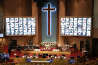 Christians on the screen attend an online Christmas service for social distancing and a precaution against the coronavirus at the Yoido Full Gospel Church in Seoul, South Korea, Friday, Dec. 25, 2020. (AP Photo/Lee Jin-man)