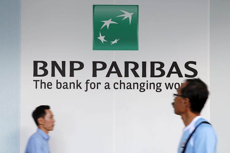People pass a BNP Paribas bank logo in Singapore's central business district in a photo shot in January 2016. (Edgar Su / Reuters)