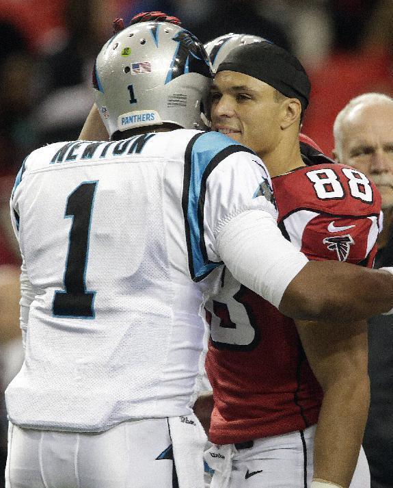 Atlanta Falcons tight end Tony Gonzalez (88) embraces Carolina Panthers quarterback Cam Newton (1) before the first half of an NFL football game, Sunday, Dec. 29, 2013, in Atlanta. (AP Photo/Dave Martin)