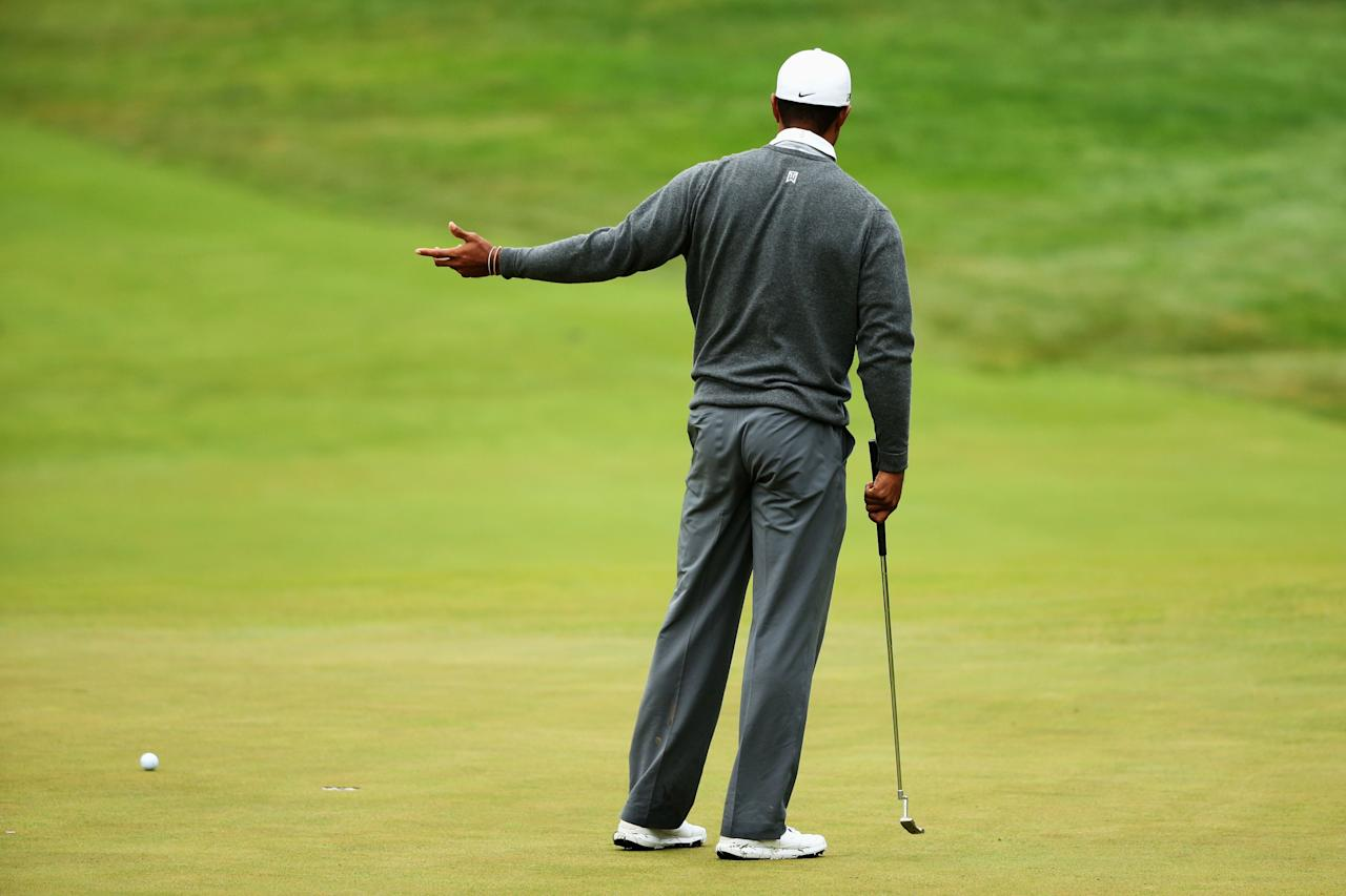 ARDMORE, PA - JUNE 14: Tiger Woods of the United States reacts to a missed putt on the 12th hole during a continuation of Round One of the 113th U.S. Open at Merion Golf Club on June 14, 2013 in Ardmore, Pennsylvania. (Photo by Andrew Redington/Getty Images)