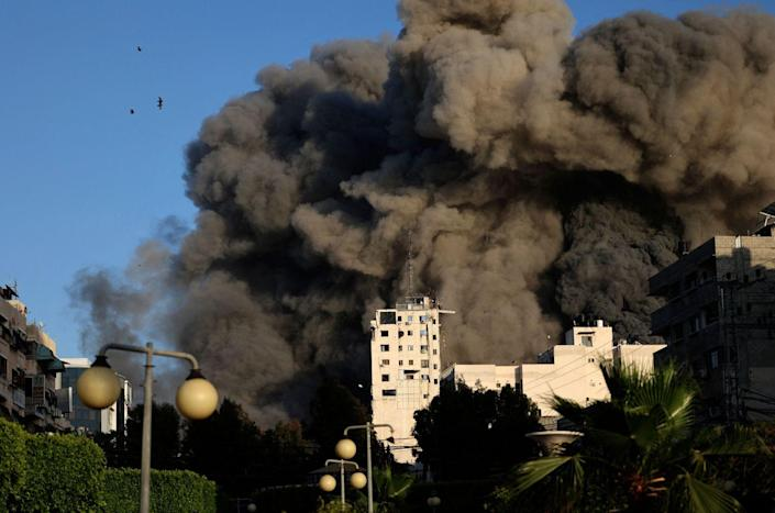 Heavy smoke rises from Shorouk Tower as it collapses
