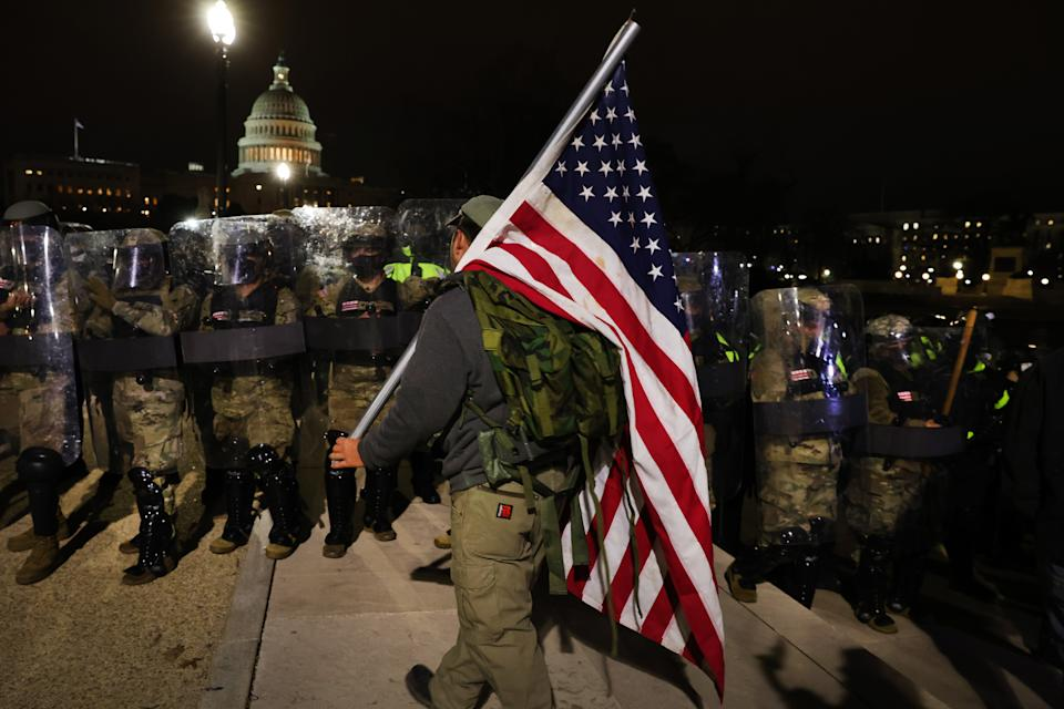 Members of the National Guard and the Washington D.C. police keep a small group of demonstrators away from the U.S. Capitol on January 06, 2021 in Washington, DC. (Spencer Platt/Getty Images)