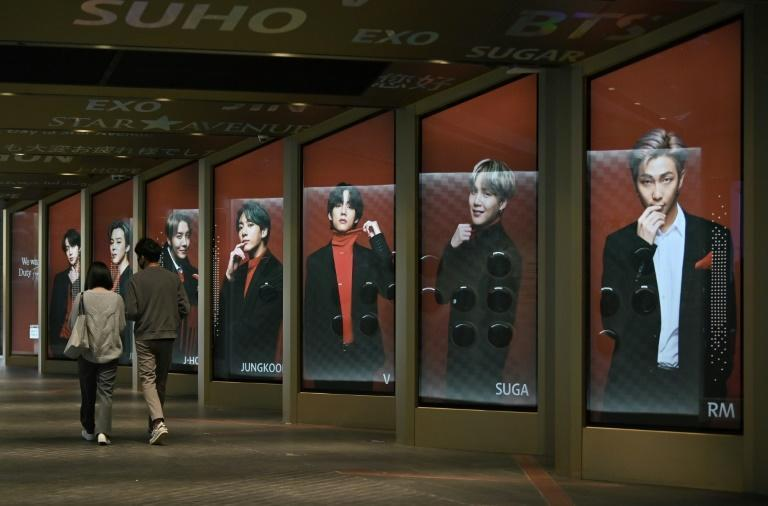 Posters showing BTS members outside a duty-free shop in Seoul