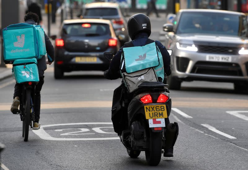 FILE PHOTO: Deliveroo delivery workers ride in London