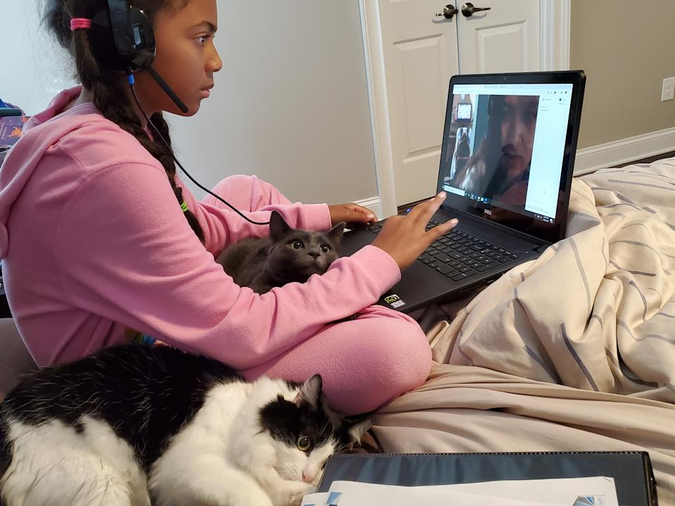 Haley Sarden, 11, on her laptop. Her mom, Judy, a homeschool expert, says learning from home isn't perfect and parents need to give themselves grace. [Photo: Judy Sarden]