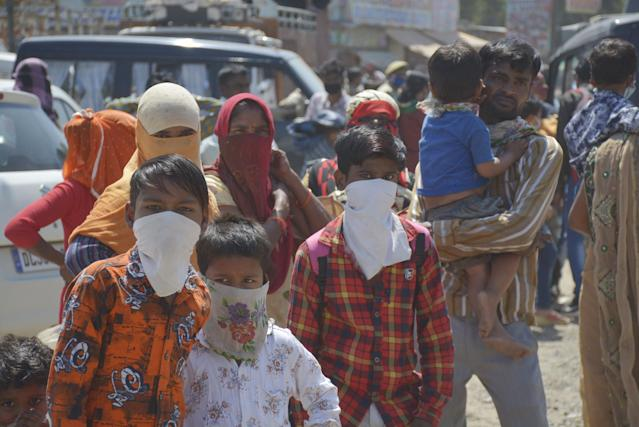 GHAZIABAD, INDIA - MARCH 28: Migrant workers seen at Lal Kuan bus stand on Day 4 of the 21 day nationwide lockdown -- to check the spread of coronavirus, on March 28, 2020 in Ghaziabad, India. (Photo by Sakib Ali/Hindustan Times via Getty Images)