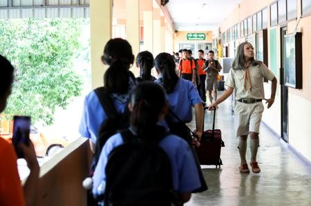 Teeraphong Meesat, 29, known as teacher Bally walks to classroom prior to the start of his English class at the Prasartratprachakit School in Ratchaburi Province
