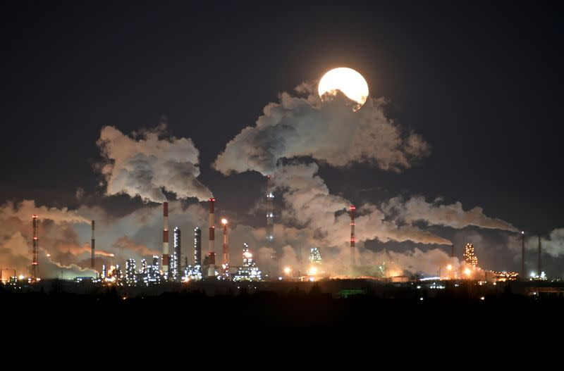 FILE PHOTO: Full moon rises over the Gazprom Neft's oil refinery in Omsk