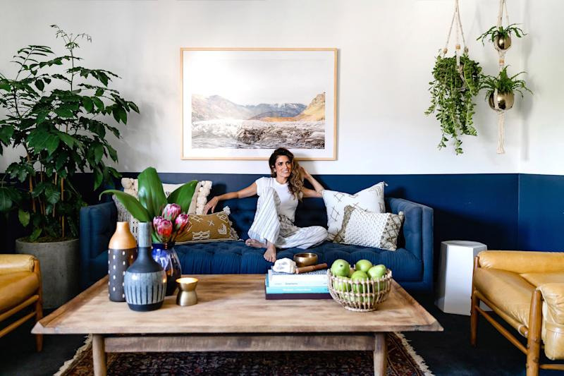 """Nikki wanted the office to feel """"alive with plants"""" and a place comfortable enough to kick off her shoes and get cozy when working."""