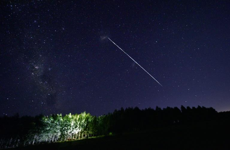 """A long-exposure image shows a trail of a group of SpaceX's Starlink satellites passing over Uruguay -- but will the company's battery of satellites end up letting it """"monopolise"""" space?"""