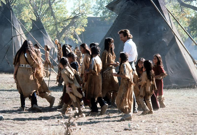 Kevin Costner with a Sioux Indian tribe in a scene from the film 'Dances with Wolves', 1990. (Photo by Tig Productions/Getty Images)