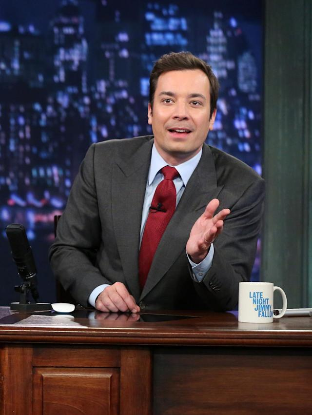 """This Feb. 1, 2013 photo released by NBC shows Jimmy Fallon, host of """"Late Night with Jimmy Fallon,"""" on the set in New York. S speculation is swirling the network is taking steps to replace the host with Jimmy Fallon next year and move the show from Burbank to New York. NBC confirmed Wednesday, March 20, it's creating a new studio for Fallon in New York, where he hosts """"Late Night."""" But the network did not comment on a report that the digs at its Rockefeller Plaza headquarters may become home to a transplanted, Fallon-hosted """"Tonight Show."""" (AP Photo/NBC, Lloyd Bishop)"""