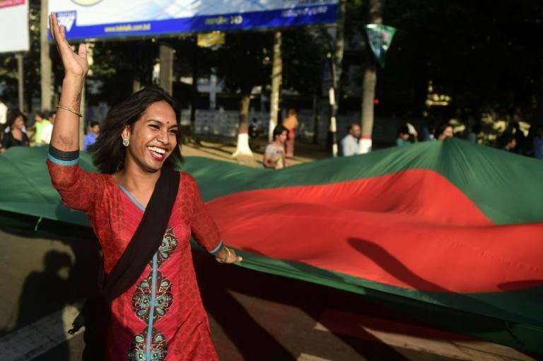 A transgender person holds a national flag during a 2014 rally in Bangladesh, which is posed to offer new rights to the minority group