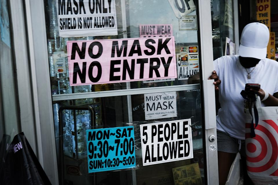 In Brooklyn, N.Y., shown here on Monday, stores still require masks. Only about 54 percent of New Yorkers are vaccinated.