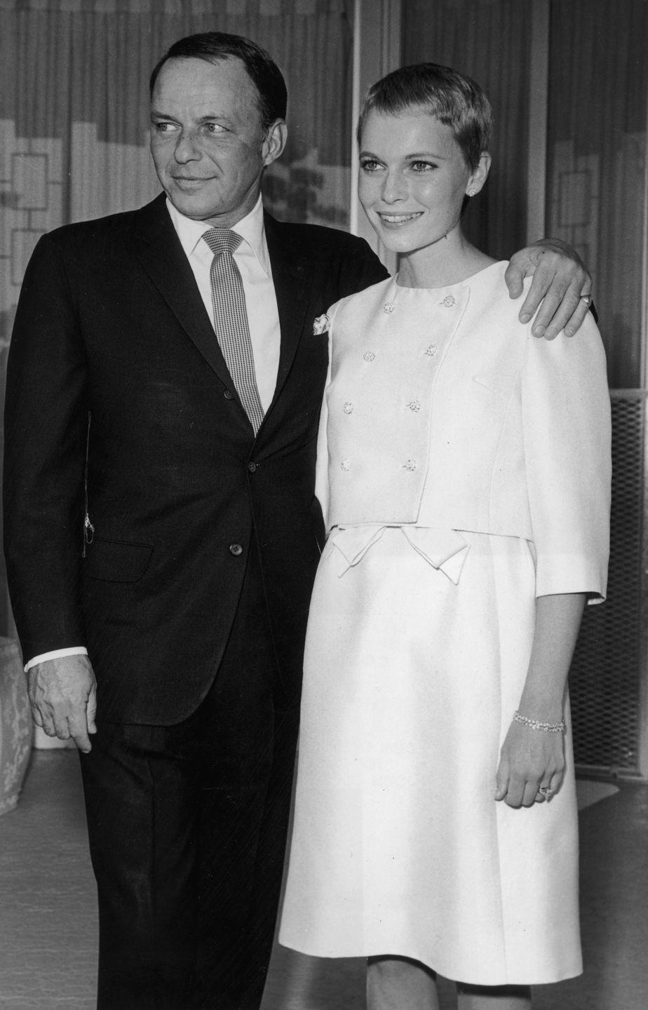 """<p>Despite a nearly 30-year age difference, Frank Sinatra and Mia Farrow wed on July 19, 1966. They got married in a <a href=""""https://www.marthastewart.com/7904799/mia-farrow-and-frank-sinatra-wedding-anniversary-day-history"""" rel=""""nofollow noopener"""" target=""""_blank"""" data-ylk=""""slk:small ceremony at The Sands Hotel in Las Vegas"""" class=""""link rapid-noclick-resp"""">small ceremony at The Sands Hotel in Las Vegas</a> and had an intimate reception at Bill Goetz's nearby estate afterward. </p>"""