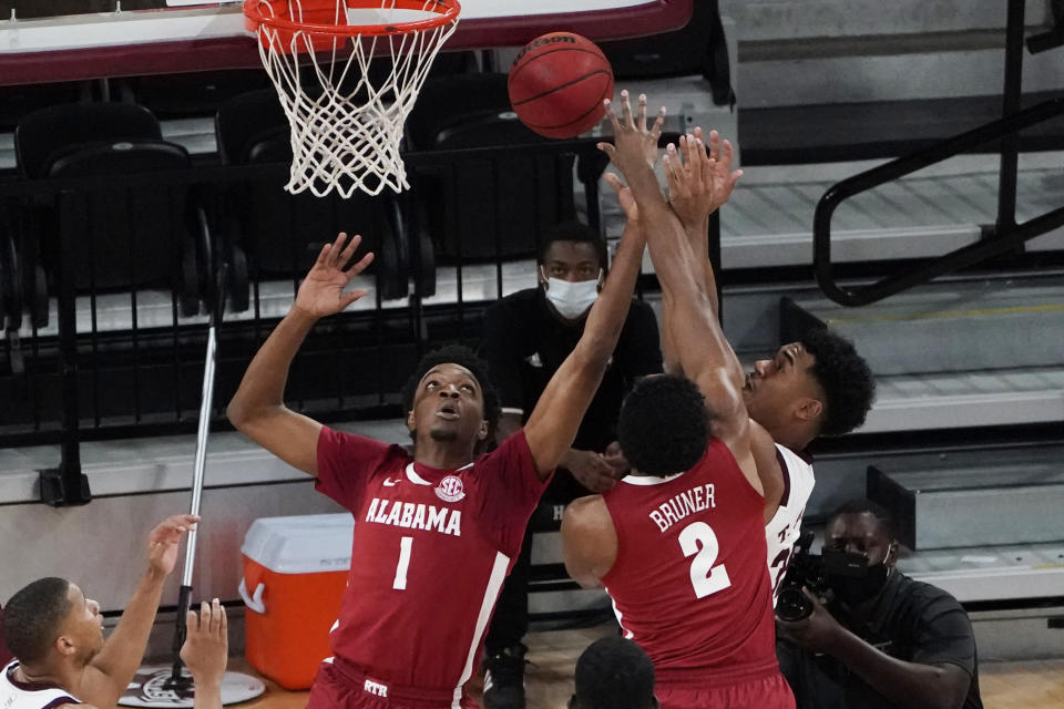 Mississippi State forward Tolu Smith, right, works against Alabama forwards Herbert Jones (1) and Jordan Bruner (2) for a rebound during the first half of an NCAA college basketball game in Starkville, Miss., Saturday, Feb. 27, 2021. (AP Photo/Rogelio V. Solis)