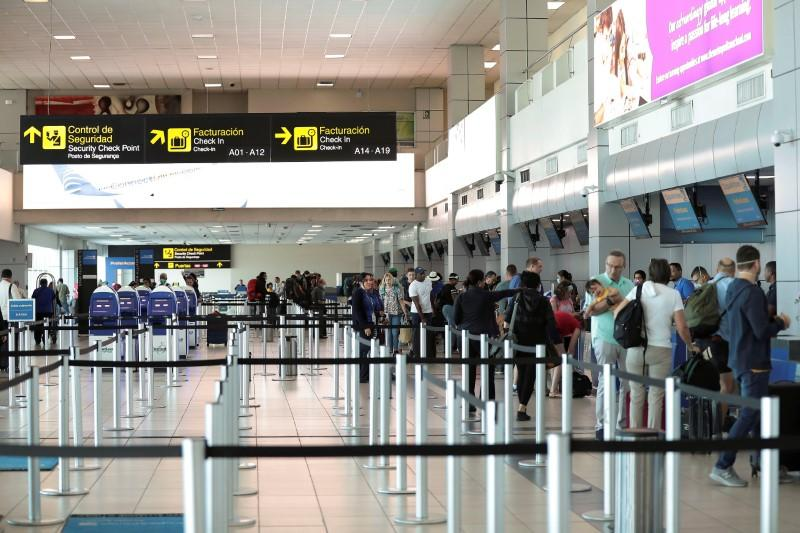 A general view shows passengers at the counters of Copa Airlines at Tocumen International Airport after the Panamanian government restricted flights in recent days due to the coronavirus disease (COVID-19) outbreak, in Panama City