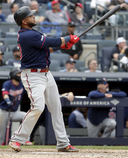 Minnesota Twins' Nelson Cruz hits a solo home run off New York Yankees relief pitcher Jake Barrett during the ninth inning of a baseball game, Saturday, May 4, 2019, in New York. (AP Photo/Julio Cortez)