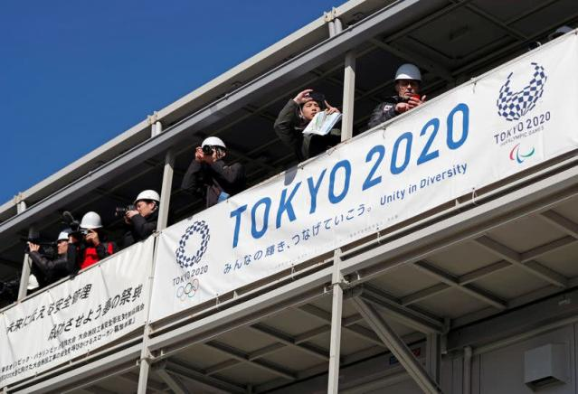 Media members report at the construction site of the Kasai Canoe Slalom Centre for Tokyo 2020 Olympic games in Tokyo