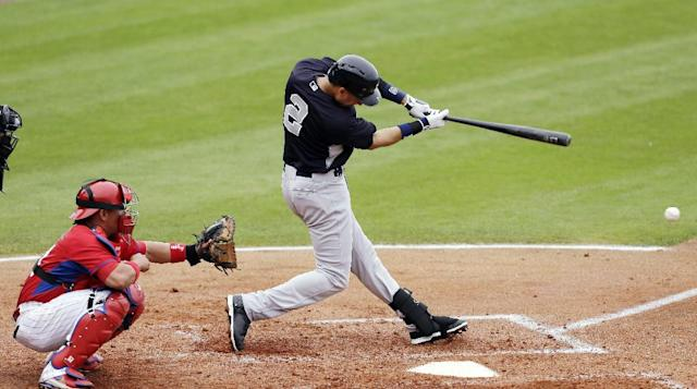 New York Yankees' Derek Jeter, right, hits a single in front of Phillies catcher Carlos Ruiz during the third inning of an exhibition baseball game against the Philadelphia Phillies, Thursday, March 6, 2014, in Clearwater, Fla. (AP Photo/Charlie Neibergall)
