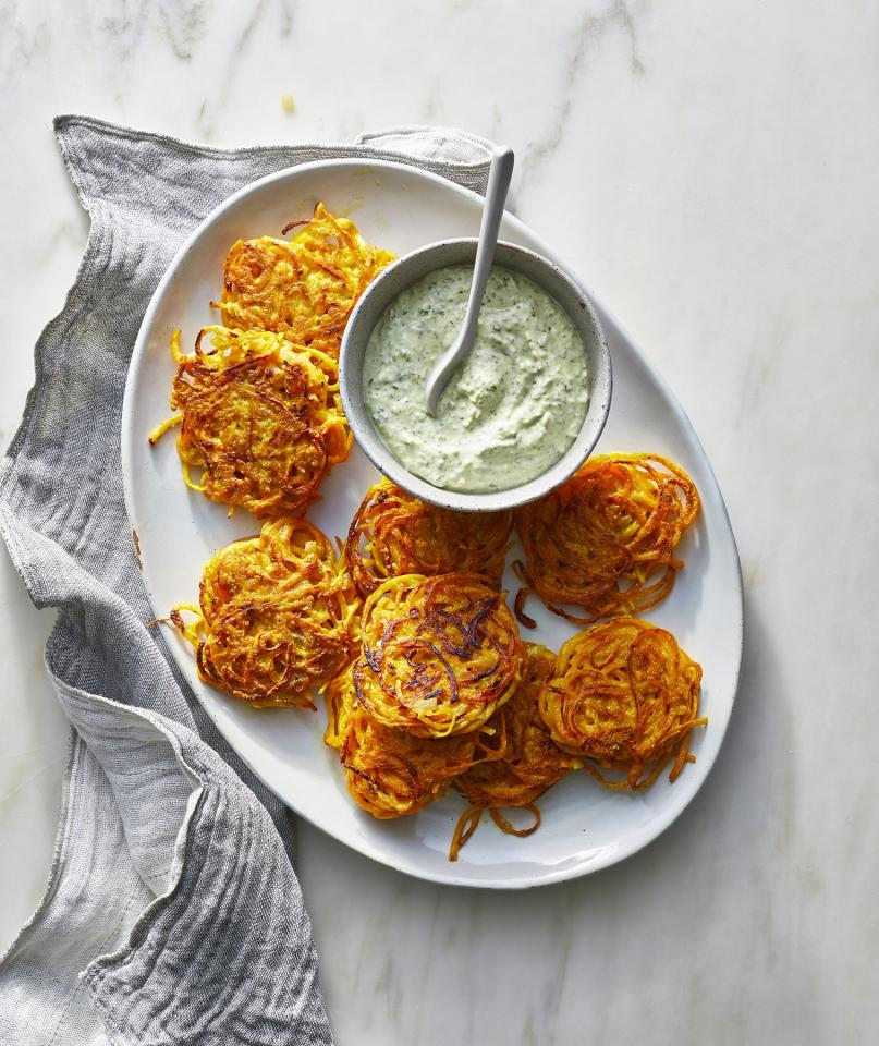 """<p>These flavorful fritters are latkes made easy: no grating or shredding required. Starting with store-bought butternut squash noodles means this crispy dish is ready in just half an hour. Make sure your oil is hot before adding the squash mixture, which will encourage browning. </p> <p> <strong>Get the Recipe</strong>: <a href=""""https://www.realsimple.com/food-recipes/browse-all-recipes/butternut-squash-fritters-cilantro-yogurt"""">Butternut Squash Fritters With Cilantro Yogurt</a></p>"""